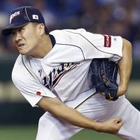 Masahiro Tanaka was a member of Japan's roster for the 2009 and 2013 World Baseball Classics, but his participation in next year's tournament is still undecided. | KYODO