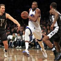 Durant, Warriors storm back to post victory over Nets