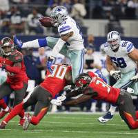 Elliott puts Cowboys in festive mood in win against Bucs
