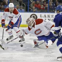 Canadiens blow lead, fall to Lightning in OT