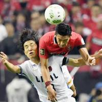 Kashima's J. League title win a fitting end to flawed format