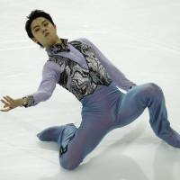 Yuzuru Hanyu competes in the short program at the Grand Prix Final in Marseille, France, on Thursday. Hanyu leads with 106.53 points heading into Saturday's free skate. | AP