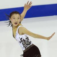Kaori Sakamoto competes in the short program on Thursday at the Junior Grand Prix Final in Marseille, France. Sakamoto is in second place going into Friday's free skate. | KYODO
