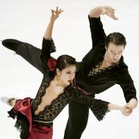 Partners Kana Muramoto and Chris Reed perform during the ice dance event's free program at the national championships on Friday in Kadoma, Osaka Prefecture. They defended their title.   KYODO