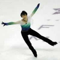 Yuzuru Hanyu performs his free-skate routine during the Grand Prix Final on Saturday in Marseille, France. | AP