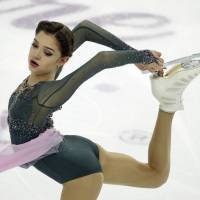 Evgenia Medvedeva of Russia performs her free-skate routine on Saturday at the Palais Omnisports in Marseille, France. | AP