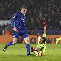 Leicester striker Jamie Vardy scores past Manchester City goalkeeper Claudio Bravo during Leicester's 4-2 win on Saturday. | REUTERS