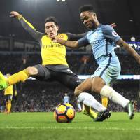 City surges in second half to beat Arsenal