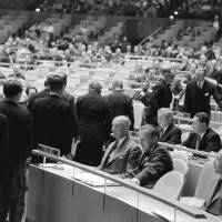 U.N. Chief of Protocol Jehan De Noue shows members of Japan's delegation to their seats at the U.N. headquarters in New York on Dec. 18, 1956.   UN PHOTO / AF
