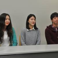 From left: Zaya Tuvshinbayar, 22, from Mongolia; Motomi Fukui, 21, who was born and raised in Thailand, graduated from an international school in Bangkok before entering Hosei University; and Tatsuo Tamura, 21, who lived in Mexico and studied at an international school until the end of junior high school | YOSHIAKI MIURA