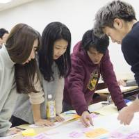 Japanese and Southeast Asian students work together in class as part of the Sophia-ASEAN International Mobility for Students, or SAIMS, program. | MASANORI DOI