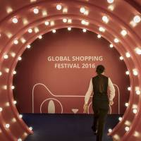 An employee walks through a gateway leading to Alibaba Group Holding Ltd.'s annual Nov. 11 Singles' Day online shopping event in November in Shenzhen, China. | BLOOMBERG