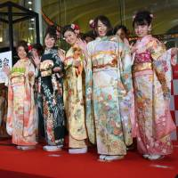 Women in kimono gather at the opening of the year's first trading day at the Tokyo Stock Exchange on Wednesday. | SATOKO KAWASAKI
