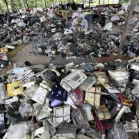 Asia's swelling piles of discarded gadgets threaten health, environment