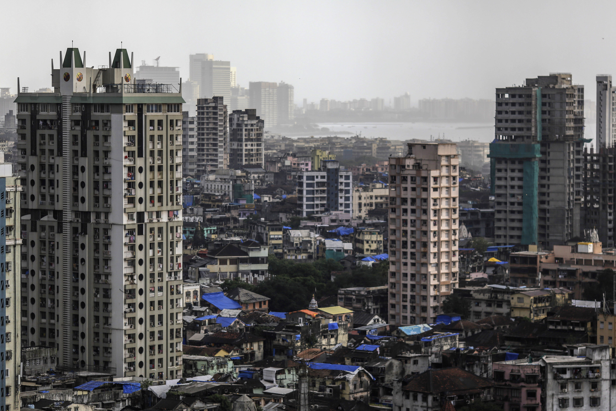 Residential and commercial buildings stand in Mumbai in September. | BLOOMBERG