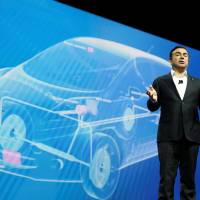 Carlos Ghosn, chairman and CEO of Nissan, speaks during a keynote address at the 2017 CES in Las Vegas on Thursday.   REUTERS