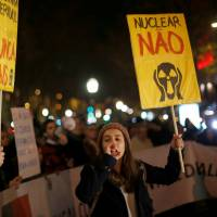 Activists protest the Spanish nuclear plant of Almaraz in front of the Spanish Embassy in downtown Lisbon, Jan 12.  | REUTERS
