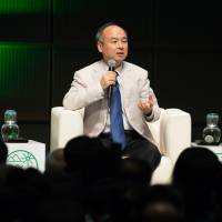 Masayoshi Son, chairman and chief executive officer of SoftBank Group Corp., speaks during a symposium in Tokyo on Sept. 9. | BLOOMBERG