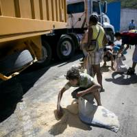 As Venezuela starves, military seen trafficking imported food along bribery chain