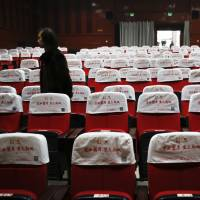 China overtakes U.S. in screens but cinemas sit empty