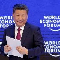 Chinese President Xi Jinping attends the World Economic Forum on Tuesday in Davos, Switzerland.   AP