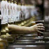 A pint of beer is served through rows of beer pumps at the Campaign For Real Ale Great British Beer Festival at Earls Court in London in this file photo. | REUTERS