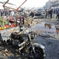 Apparent Islamic State suicide bombers kill 18 in Baghdad markets