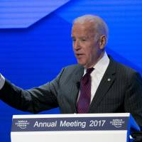 Biden at Davos urges Trump to keep up cancer 'moonshot'