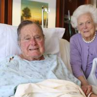 Bush ready for oyster stew, set to leave intensive care, as wife is discharged