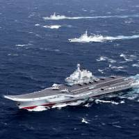 China's only aircraft carrier, the Liaoning, and its accompanying vessels takes part in a drill in the South China Sea in this undated photo. | REUTERS