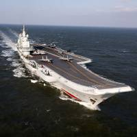 The Liaoning, China's only aircraft carrier, sails Dec. 24 during military drills in the Pacific. Taiwan's defense minister warned on Dec. 27 that enemy threats were growing daily after China's aircraft carrier and a flotilla of other warships passed south of the island in an exercise as tensions rise. | AFP-JIJI