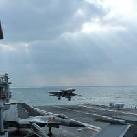 Chinese J-15 fighter jets practice on the deck of the Liaoning aircraft carrier during military drills in the Yellow Sea, off China's east coast on Dec. 23. | AFP-JIJI