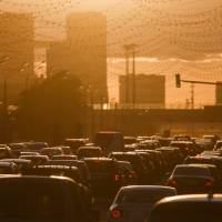 Cars are stuck in a traffic jam during sunset in Moscow in 2015. | REUTERS