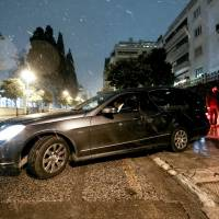 A hearse leaves a residence block where Russian Consul Andrey Malanin was found dead in his apartment in Athens Monday. | COSTAS BALTAS / INTIMENEWS VIA REUTERS