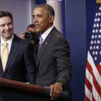Obama makes surprise visit to briefing to praise press secretary for 'integrity'