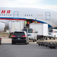 U.S.-expelled Russian diplomats fly home with kin