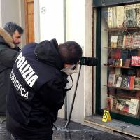 Exploding package outside rightist Florence bookstore costs bomb squad officer eye, hand