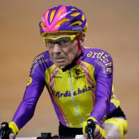 French cyclist Robert Marchand, 105, rides on his way to cover 22.528 km (14.08 miles) in one hour to set a new record at the indoor Velodrome National in Montigny-les-Bretonneux, southwest of Paris Wednesday. | REUTERS