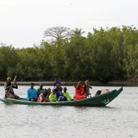 Ousted Gambian leader refuses to budge; tourists flee as regional troops prepare to intervene