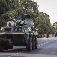 A convoy of Senegal soldiers heads toward the Gambia boarder with Senegal near Karang, Senegal, Thursday. Senegalese troops charged into neighboring Gambia late Thursday to support the country's newly inaugurated president, while longtime ruler Yahya Jammeh showed no sign of stepping down. | AP