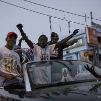 People celebrate the inauguration of new Gambia's President Adama Barrow in the Westfield neighborhood on Thursday in Banjul. | AFP-JIJI