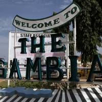 A sign welcoming people to The Gambia is seen at Senegambia in Banjul Saturday.   REUTERS