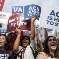 Supporters of the Affordable Care Act celebrate after the Supreme Court up held the law in a 6-3 vote in Washington on June 25, 2015. | REUTERS