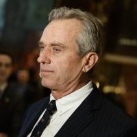 Robert F. Kennedy Jr. talks with reporters in the lobby of Trump Tower in New York on Tuesday after meeting with President-elect Donald Trump. | AP