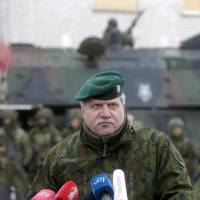 Chief of Defence of Lithuania, Jonas Vytautas Zukas, speaks to media during 12 NATO nations exercise in urban warfare during Iron Sword exercise in the mock town near Pabrade, Lithuania, Dec. 2. | REUTERS