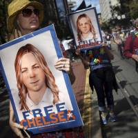 Obama commutes Manning's term, grants clemency to hundreds; Assange mum on promise