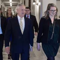 Retired U.S. Marine Corps Gen. James Mattis, President-elect Donald Trump's nominee for defense secretary, walks to a private meeting on Capitol Hill in Washington on Wednesday. | AFP-JIJI