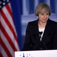 May offers guarded praise for U.S. 'renewal' under Trump