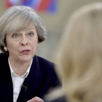 U.K.'s May vows to seek ambitious EU deal and work with Trump