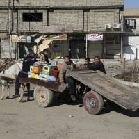 Life returning to liberated east Mosul amid grisly Islamic State discoveries